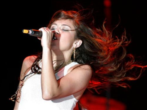 Miley Cyrus puts on a show for her fans at the Stadium of Fire in Provo.  July 4, 2008.  Photo by Stuart Johnson